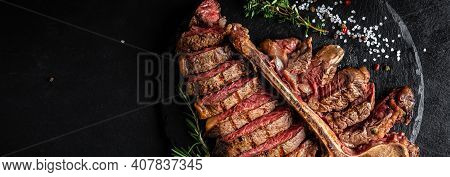 Beef T-bone Steak. Medium Rare Sliced Grilled Striploin Beef Steak With Fork And Knife. American Mea