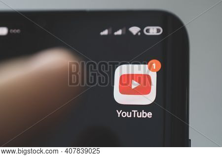 Icon Of The Youtube, App On The Screen Of A Black Smartphone. Barnaul, Russia, February 10, 2021