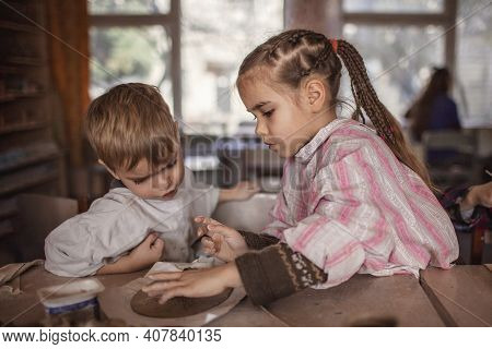 Cute Little Kids Playing Together With Modeling Clay In Pottery Workshop, Craft And Clay Art, Child