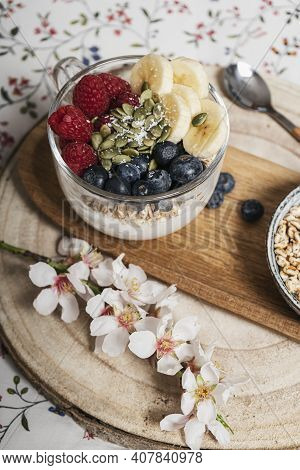 Breakfast In Bed, Table With A Cup With Blueberries, Bananas, Raspberries And Yogurt