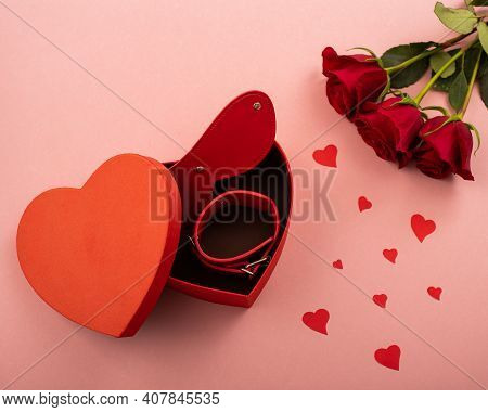 Bdsm Set In A Box In The Form Of A Heart And Red Roses On A Pink Background. Valentines Day Gift Ide