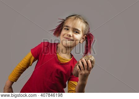 Freakish Kid With Pinky Hair In Eyeglasses Holds Misshapen Wrong Color Fruits And Vegetables, Giants