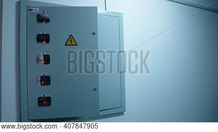 Open Door Of The Electrical Panel At The Entrance Of The Apartment Complex With A High Voltage Hazar