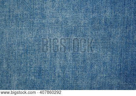 Denim Light Blue Jeans Fabric. Denim Background Texture For Design. Canvas Denim. Blue Jeans Texture