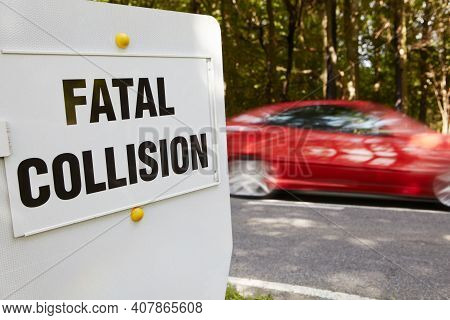 Fatal Collision Sign Next To Scene Of Accident On Busy Road