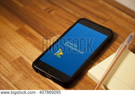 São Paulo, Brazil. Feb 12, 2021: Cell Phone With The Image Of Emergency Aid On The Wooden Table With