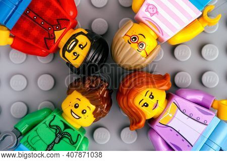 Tambov, Russian Federation - January 17, 2021 Four Lego Tamily Minifigures - Mother, Father, Son And