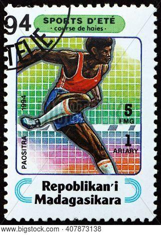 Malagasy - Circa 1994: A Stamp Printed In Malagasy, Madagascar Shows Hurdles, Sport, Circa 1994