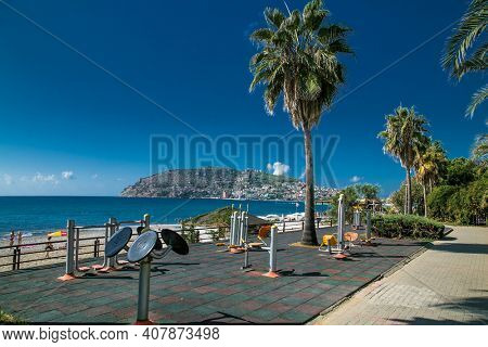 Alanya, Turkey - October 20, 2020: Outdoor workout area with exercise machines on the promenade near beach in Alanya. Turkey. A place for sports and recreation with a beautiful view of the cost