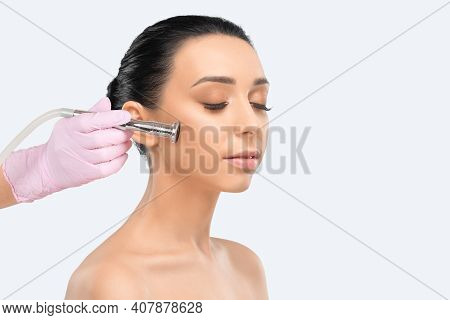 Cosmetologist Makes  Procedure Microdermabrasion On The Face Against Acne And Blackheads. Women's Co
