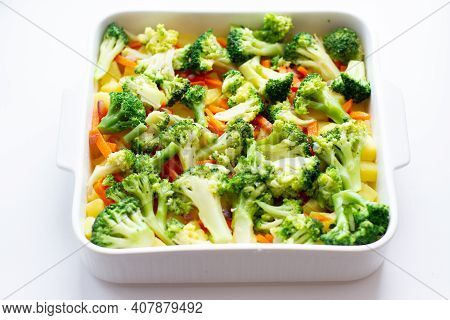 Raw Vegetables On A Baking Tray. Cooking Vegetables For Baking In Oven Dish Top View. Broccoli, Carr