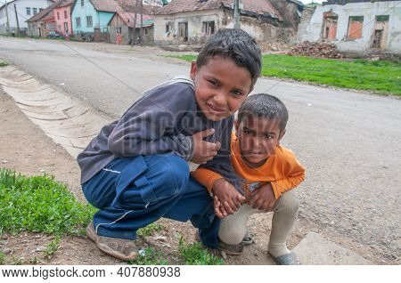 5-16-2018. Lomnicka, Slovakia. A Close-up Of Two Roma Or Gypsy Boys In An Abandoned Community In The