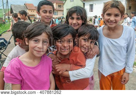 5-16-2018. Lomnicka, Slovakia. A Close-up Of A Roma Or Gypsy Smiling Children In An Abandoned Commun
