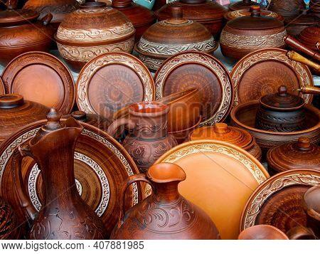 Ceramic Clay Terracotta Jug, Pot, Vase, Kitchen Souvenirs On Shelf At Street Handicraft Pottery Shop