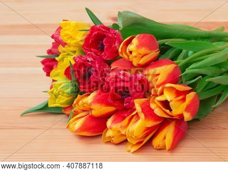Bouquet Of Colorful Fresh Spring Tulips On Wooden Table. Selective Focus.