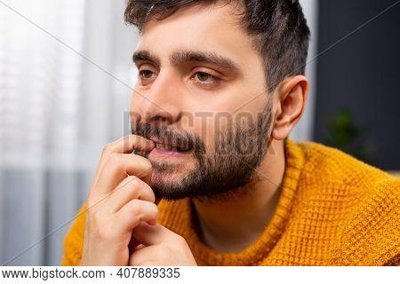 Close-up Portrait Of An Unhappy Man, A Sad And Thoughtful Young Businessman Who Thinks Deeply, Distu