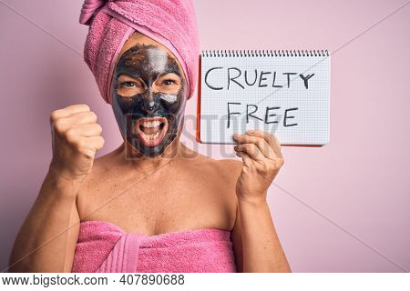 Middle age brunette woman wearing cruelty free beauty black face mask annoyed and frustrated shouting with anger, crazy and yelling with raised hand, anger concept