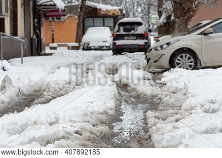 Slush, Snow Mixed With Mud On The Road. The Road Is Not Cleared Of Snow.