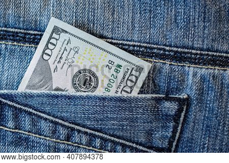 One Hundred Dollars In Jeans Pocket. Close Up One Hundred Us Dollar As Symbol Of Poverty And Bankrup