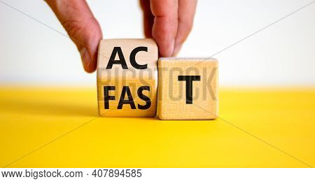 Time To Act Fast Symbol. Businessman Turns A Wooden Cube With Words 'act Fast'. Beautiful Yellow Tab