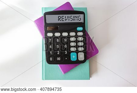 Revising, Text On The Calculator. Multi Colored Notepads On White Background