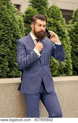 Stay Connected. Businessman Talk Mobile Phone. Handsome Bearded Man With Cell Phone Outdoor. Mobile
