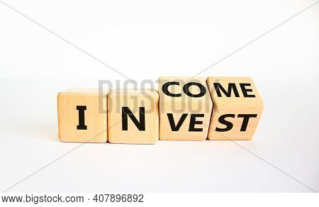 Invest Or Income Symbol. Turned Wooden Cubes And Changed The Word 'invest' To 'income'. Beautiful Wh