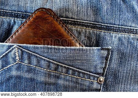 Leather Wallet In Jeans Pocket. Brown Leather Wallet