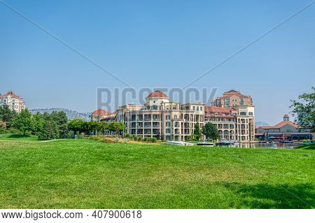 Landscape With Luxury Residential Buildings And Boat Pier At Front