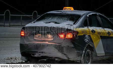 Close-up Of A Taxi Car In Winter At Night Waiting For Customers, Yandex Taxi Company. Mogilev, Belar