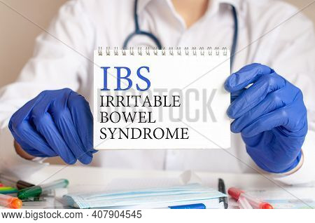 Doctor Holding A Tablet With Text: Ibs. Ibs - Irritable Bowel Syndrome, Medical Concept.
