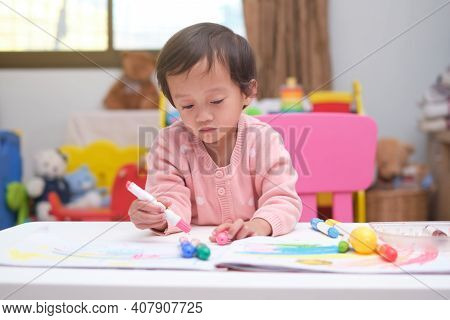 Cute Little Asian 2 - 3 Years Old Toddler Baby Girl Child Coloring With Crayons At Home, Creative Pl