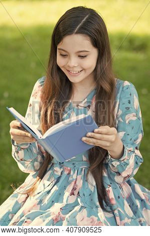 For Your Reading Pleasure. Happy Girl Read Book In Summer Park. Small Child Enjoy Reading Outdoors.