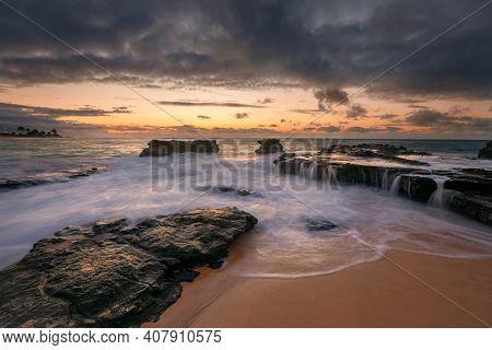 colorful sunrise from Sandy Beach, Oahu, Hawaii USA