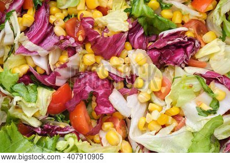 Fresh Salad With Tomatoes, Corn And  Salad Leaves - Frisee, Romano, Mangold.