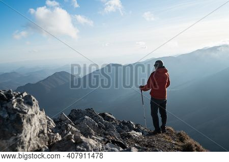Happy Smiling Man Dressed Bright Orange Softshell Jacket With Backpack Hand In Hand Girlfriend Point