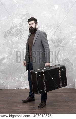 Luggage Insurance. Man Well Groomed Bearded Hipster With Big Suitcase. Travel And Baggage Concept. H