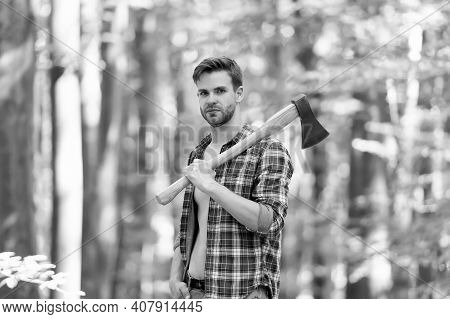 Usual Work. Man Ready For Splitting Wood And Cutting Firewood With Axe. Prepare To Chop Down Tree. C