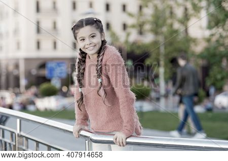 Little Cutie. Adorable Little Kid With Charming Smile On Summer Day. Little Child With Brunette Hair