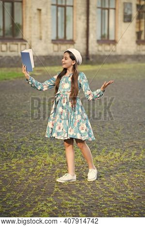 Take Your Fantasy Off The Shelf. Happy Girl Read Fantasy Book Outdoors. Small Kid Enjoy Reading. Fan