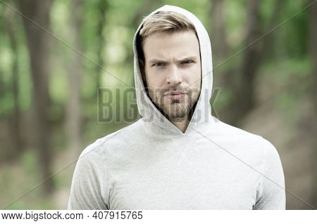Macho Man. Man In Hood. Casual Style. Male Fashion. Unshaven Guy Outdoor. Seriousness And Masculinit