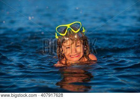 Kids Snorkel Swimming. Snorkeling Diving Kid. Boy With Mask Exploring Underwater