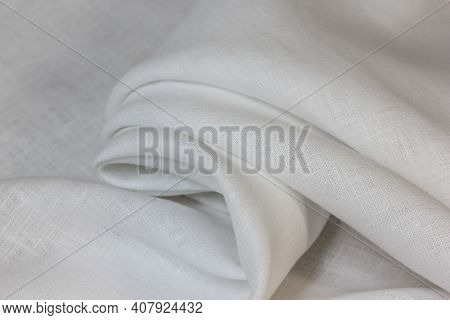 White Softened Linen Is Folded Into A Drapery.eco-friendly The Fabric Is Softened In The Home.