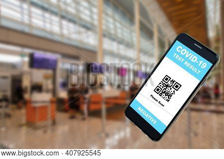 Mobile Phone App Showing Negative Covid-19 Test Result With Qr Code Against The Background Of An Air