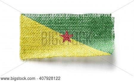 French Guiana Flag On A Piece Of Cloth On A White Background
