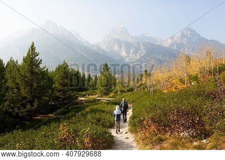 Family Of Two, Father And Son, Hiking And Enjoying The Gorgeous Views In Grand Teton National Parl,