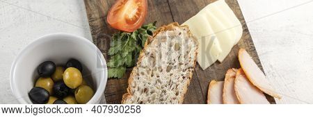 Spanish Tapas Or Snack Or Appetizer. Banner With Sliced Bread On Serving Board With Cheese, Smoked C