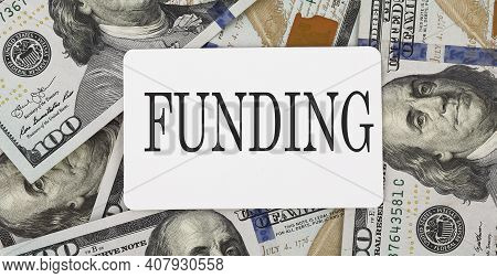 Text Funding On The Dollars Background,business Concept