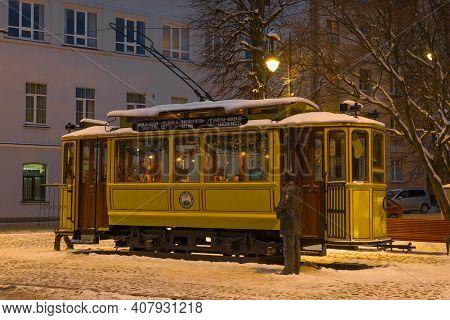 Vyborg, Russia - February 08, 2021: Old Tram Cafe In February Twilight