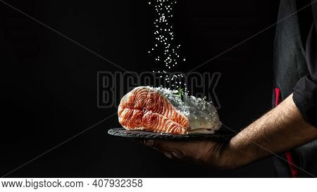Chef Prepares Salmon Steak, Process Of Sprinkling With Spices And Salt In A Freeze Motion, Marinatin